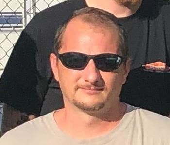 Male Employee, brown hair and sunglasses